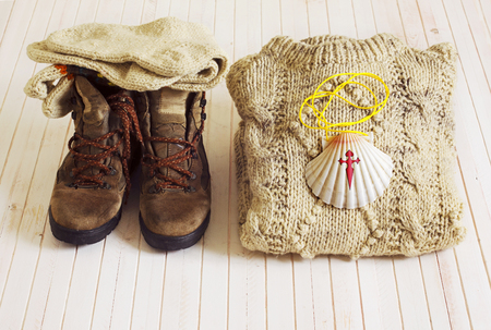 way of st  james: Pilgrim shell, boots and woolen clothes for Way of St James With to Compostela Cathedral, Spain. Santiagos road