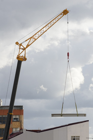 maneuverable: mobile truck crane giant  vehicle in construction site in the city