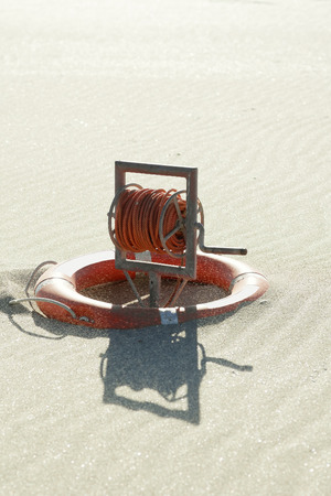 beach buoy: life ring buoy in desert beach Stock Photo