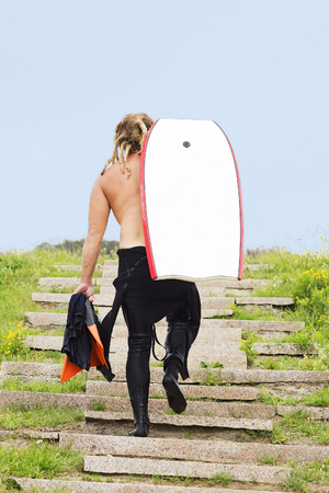 boarder: body boarder  man  in the stairway to the beach Stock Photo