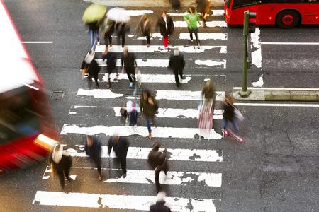 dangerously: people walking in the crosswalk at  dawn dangerously Stock Photo