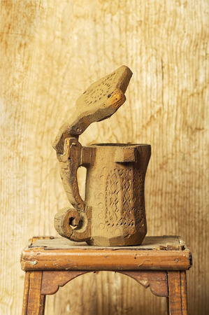 tankard: antique wooden mug with  wooden background