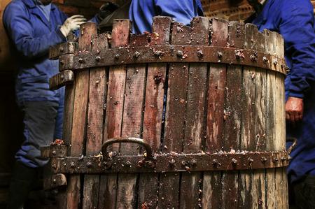 winepress: making wine of grape farmers in traditional winepress in Villarejo de Orbigo, Leon, Spain; Selective focus