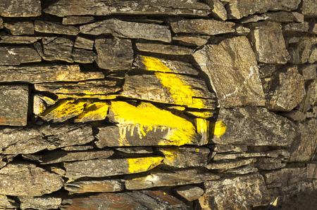 camino de santiago: Way of St James , Camino de Santiago, yellow arrow mark  to Compostela Cathedral ,Galicia, Spain