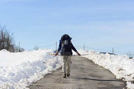 way of st  james: pilgrim in winter with snow  in way of St James,  Camino de  Santiago, to Compostela, Galicia, Spain