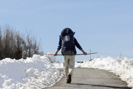 saint jacques: pilgrim in winter with snow  in way of St James,  Camino de  Santiago, to Compostela, Galicia, Spain