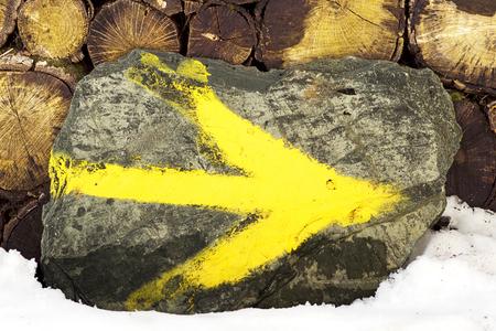 camino: Way of St James , Camino de Santiago, yellow arrow mark  to Compostela Cathedral ,Galicia, Spain
