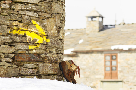 way of st  james: Way of St James , Camino de Santiago, yellow arrow mark and pilgrim boots  to Compostela Cathedral ,Galicia, Spain