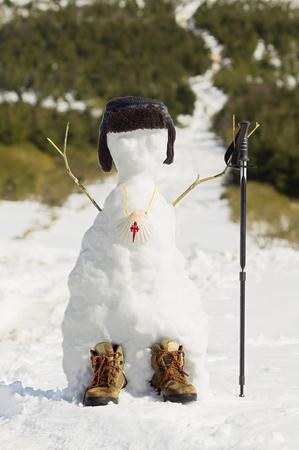 camino de santiago: snowman pilgrim with scallop shell sign in the Way of St James,  Camino de  Santiago,  Compostela, Galicia, Spain