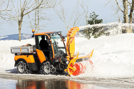blow: snow blower machine vehicle working  removing  the snow from the highway Stock Photo