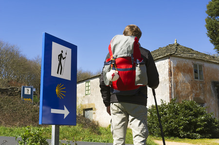 way of st  james: young pilgrim near of Palas de Rei village in Way of St James, Camino de Santiago, to Compostela, Galicia, Spain