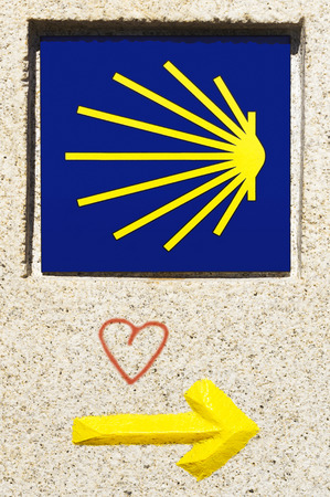 saint jacques: shell and yellow arrow sign marks for pilgrims in Way of St James,  Camino de  Santiago, to Compostela, Galicia, Spain Stock Photo