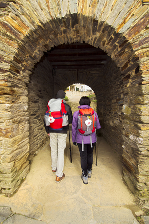 camino de santiago: pilgrims in Portomarin village , Way of St James,  Camino de  Santiago, to Compostela, Galicia, Spain Stock Photo