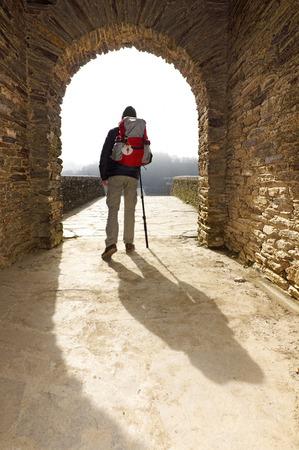 compostela: pilgrim in Portomarin village , Way of St James,  Camino de  Santiago, to Compostela, Galicia, Spain