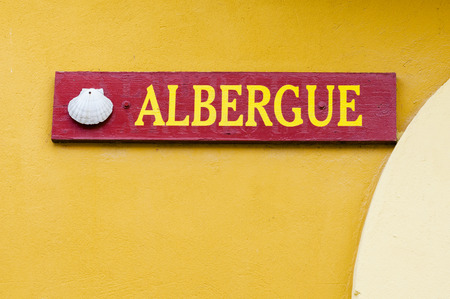 compostela: shell and albergue , hostel , sign for pilgrims in Way of St James,  Camino de  Santiago , Compostela Stock Photo