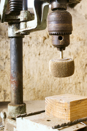 mud house: DIY workshop ,wooden workbench,  of handyman with old electric  grinder  in antique  mud house