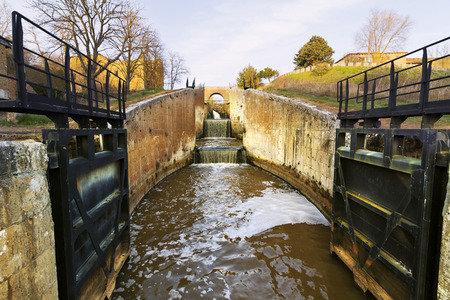 floodgates: Canal of Castile ,Canal de Castilla, It was built to grain transport  and then it was reconverted  to be a huge irrigation system ; Palencia, Spain