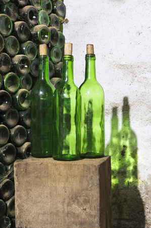 ferment: empty wine bottles in antique cellar