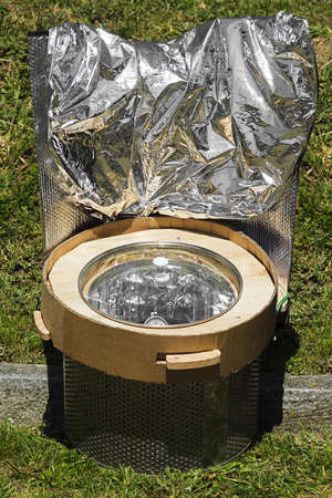 parabolic mirror: solar cooker with reflective panels make to cheap materials ,  renewable green energy
