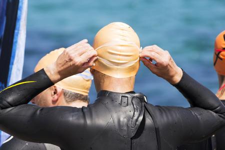 swim race: triathletes preparing to begin the swim race portion Stock Photo