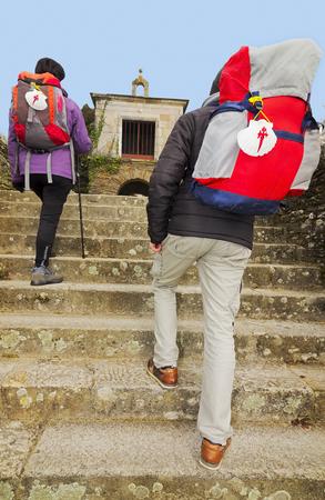 way of st  james: pilgrims in Portomarin village , Way of St James,  Camino de  Santiago, to Compostela, Galicia, Spain Stock Photo