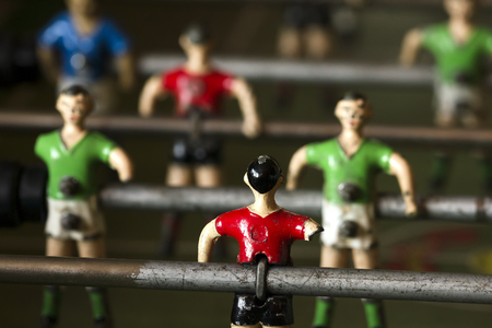 mettalic: mettalic soccer players of table football  with one arm only , selective focus ; concept disabled sport