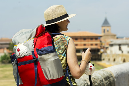 pilgrim in the Hospital de Orbigo bridge, Way of St James, Camino de Santiago, to Compostela, Leon, Spain