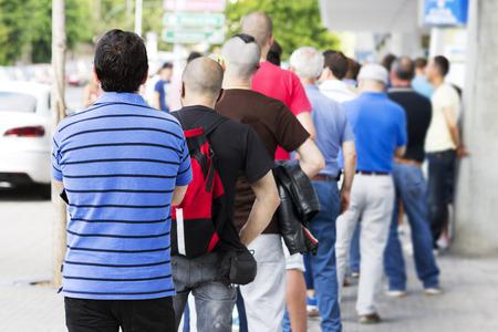 far away look: people  queue  in line, selective focus Stock Photo