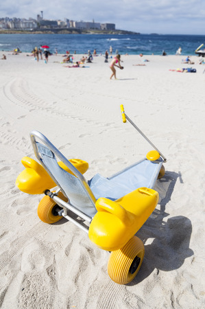 Specifically designed wheelchair for what disabled people can access the beach and bathing in the sea