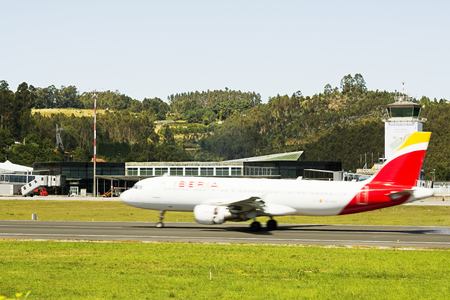 Coruna , Spain - August 2, 2016 : Iberia plane landing on the airport of Alvedro, Coruna, Spain