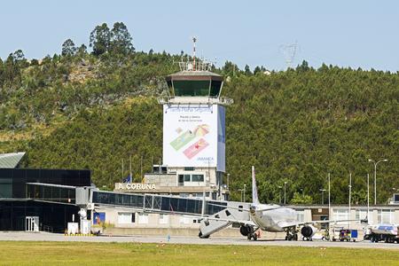 Coruna, Spain - August 2 2016: air traffic control tower of Alvedro With Air Europa plane on the terminal, Coruna, Spain
