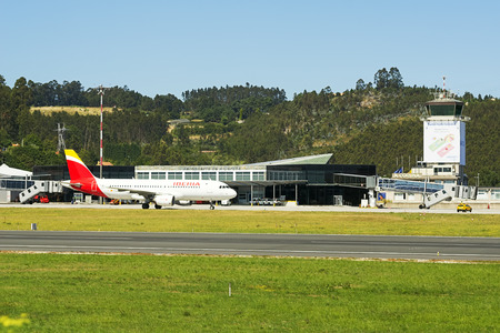 Coruna , Spain - August 2, 2016 : Iberia plane flowing to the terminal after landing in  airport of Alvedro, Coruna, Spain