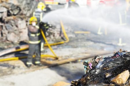 firefighters in industrial warehouse fire