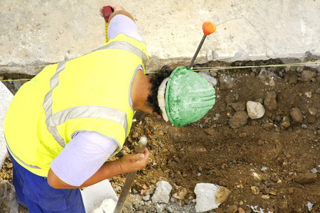 construction worker working in the placement of water and sewer pipes