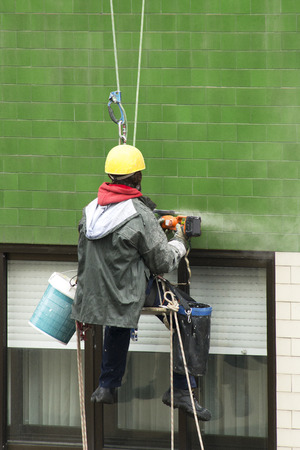 heights job: vertical worker in  heights working with ropes in danger situation