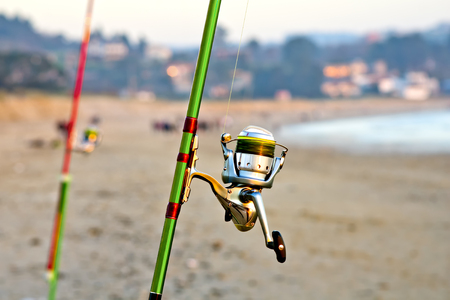 fishing rods with spinning and reel of a fisherman for surfcasting in beach shore  Stock Photo
