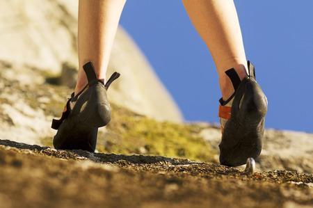 woman rock climber feet close up Stock Photo