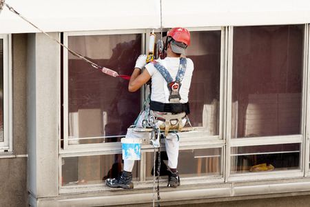 vertical worker in  heights working with ropes Stock Photo
