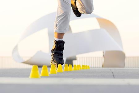 blading: roller skater with inline skates in sea promenade , extreme sport athlete
