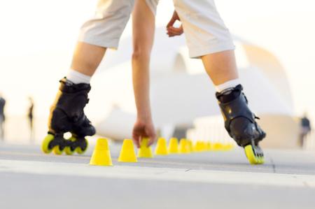 skate park: roller skater with inline skates in sea promenade , extreme sport athlete