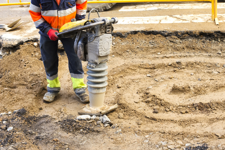 jack tar: compactor plate , vibratory rammer ,  jumping jack , in construction site with worker