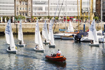 Coruna, Spain 11 August, 2017 :  48 Snipe World Championship Regatta , sailboats leave the port to the racing area Editorial