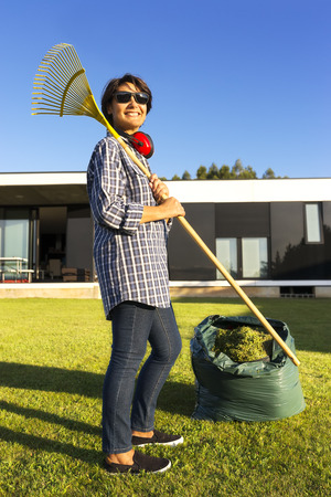 woman cutting the  grass in modern house