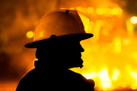 firefighter in action, silhouette Stock Photo