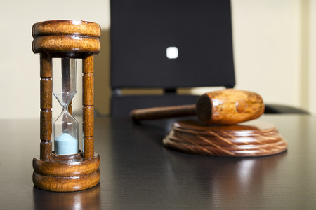 hourglass time concpept and auction bid sale judgment unfocused mallet Stock Photo