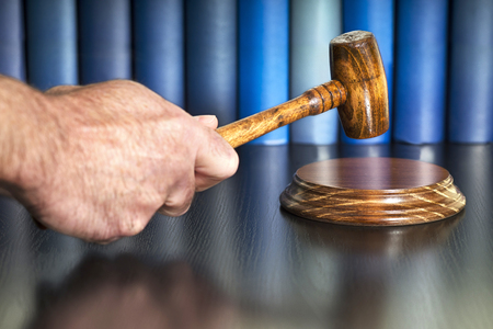 gavel mallet auction bid sale judgment with books Stock Photo