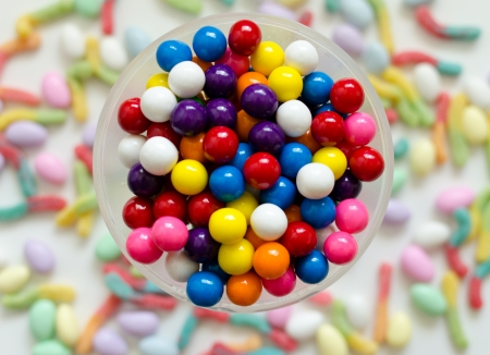 multicolored gumballs: Gum balls with a candy background