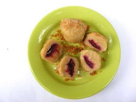 plum dumpling with sugar photo