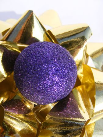 purple christmas decoration on a golden ribbon-2 Stock Photo - 6080255