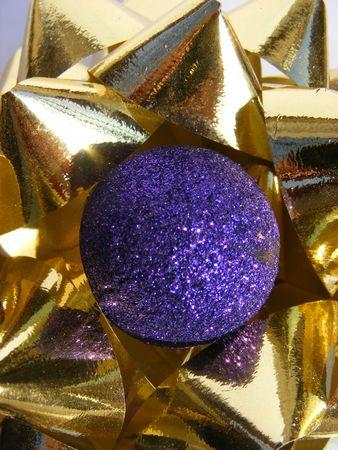 purple christmas decoration on a golden ribbon Stock Photo - 6080260